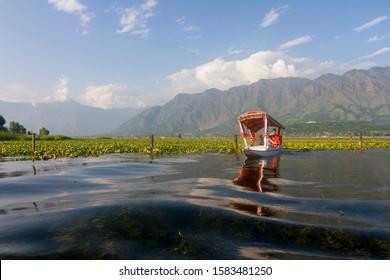 Dal Lake,Srinagar,kashmir,India-July17,2014:Tourist enjoying Boat ride at Dal Lake after Sunset,Srinagar,Jammu and Kashmir,India