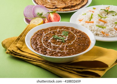 Dal Makhani or daal makhni, indian lunch/dinner item served with plain rice and butter Roti / Chapati /Paratha and salad