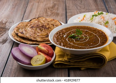 Dal Makhani or daal makhni is a popular indian lunch/dinner item served with plain rice and butter Roti /Chapati /Paratha and salad