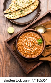 Dal makhani or daal makhni is a popular food from Punjab / India made using  whole black lentil, red kidney beans, butter and cream and served with garlic naan or Indian bread or roti