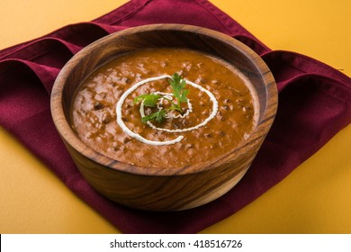 dal makhani or daal makhni, served in a wooden bowl,selective focus