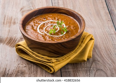 dal makhani or daal makhni, served in a wooden bowl, selective focus