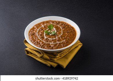dal makhani or daal makhni, served in a white ceramic bowl, selective focus