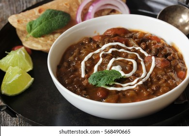 Dal Makhani - Slow cooked creamy Indian curry with Black lentils and Red kidney beans served with Roti or Paratha