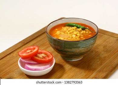 Dal Tadka or Channa Dal or Punjabi Yellow Dal with Tadka with Indian Bread or Lachha Paratha