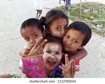 Dala district,  Yangon,  Myanmar. 4 February 2018. Four Burmese children from the Dala squatter village posing for a photograph.