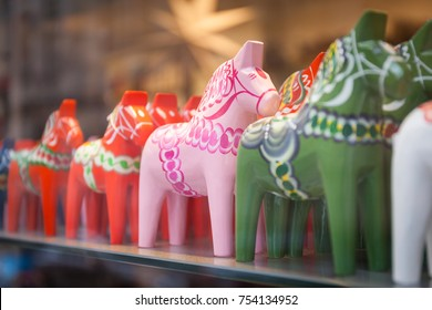 Dala on sales in a tourist shop in Stockholm. Dala is a traditional carved and painted wooden horse statuette originating from Dalarna that has become a symbol of Sweden.