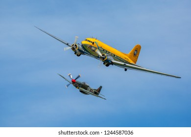 DALA JÄRNA, SWEDEN - AUGUST 10, 2018: North American P-51 Mustang of Nordic Warbirds and Douglas DC-3 Skytrain of Vallentuna Aviators arriving at Flygfesten 2018.