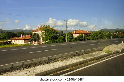 DALAMAN, TURKEY - MAY 1 2014: On the road between Dalaman and Marmaris turkish towns. View of the roadside through the dirty bus window
