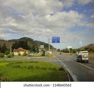 DALAMAN, TURKEY - MAY 1 2014: On the road between Dalaman and Marmaris turkish towns. View of the roadside through the dirty bus window
