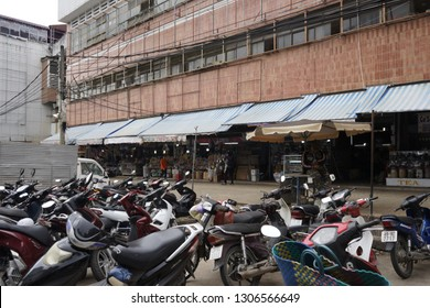 Dalat City / Vietnam - Dec 17, 2018: Bike parking in front of Dalat old Market intersections. At night, bikes are not allowed to park to give space for street vendors.