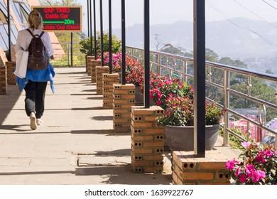 Dalat, Vietnam 1.18.2020. girl walks on the terrace of an outdoor cafe