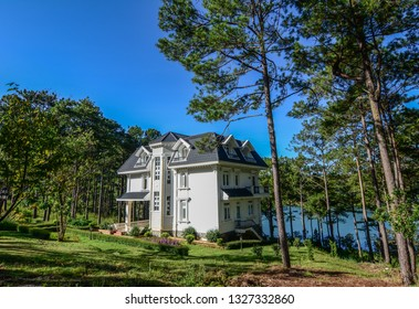 Dalat, Vietnam - Apr 5, 2015. Luxury villa with many pine trees at sunny day in Dalat, Vietnam.