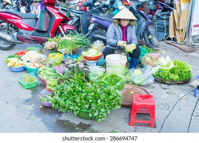 DALAT, VIETNAM - April 15, 2015: Unidentified women sell fresh vegetables and fruit at the central city market