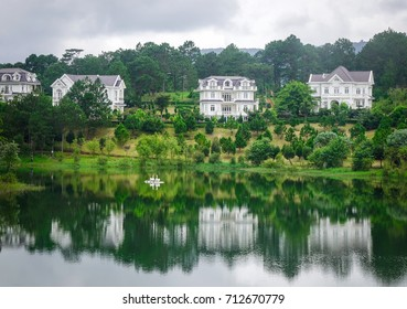 Dalat, Vietnam - Aug 17, 2017. Lake scenery with summer resort in Dalat, Vietnam. Da Lat is a popular tourist destination, located 1500m above sea level on the Langbian Plateau.