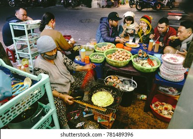 Dalat, Vietnam - Feb 18, 2017 - Grilled girdle cake (Banh Trang Nuong) selling at 112 Nguyen Van Troi, a famous Vietnamese street stall/ eatery, a popular Vietnamese food in Da lat at night
