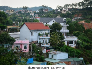 Dalat, Vietnam - Jul 5, 2016. Many houses on the hill in Dalat, Vietnam. Da Lat in Central Highlands, is centered around a lake and golf course, and surrounded by hills, pine forests.