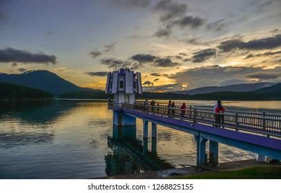 Dalat, Vietnam - Nov 11, 2018. People visit the Deck View of Lake Tuyen Lam at sunset in Dalat, Vietnam.