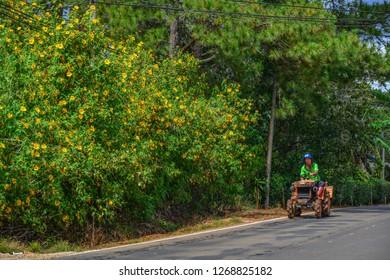 Dalat, Vietnam - Nov 12, 2018. Farm tractor on mountain road in Dalat, Vietnam. Dalat is located 1,500 m above sea level in the Central Highlands region.