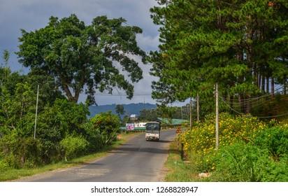 Dalat, Vietnam - Nov 12, 2018. Mountain road at autumn in Dalat, Vietnam. Dalat is located 1,500 m above sea level in the Central Highlands region.