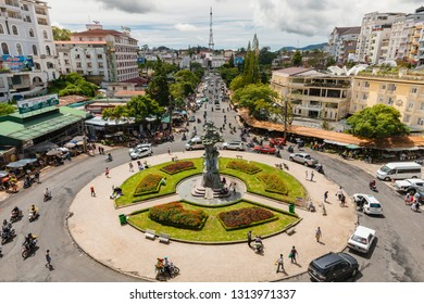 Dalat, Vietnam - September 23, 2018: People walk and ride a motorbike at the central Market Square on September 23, 2018, in Dalat, Vietnam