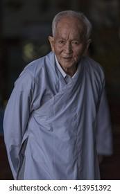 Dalat, Vietnam-November 14, 2016:Unidentified Vietnamese oldman pose for camera during local ceremony in Dalat City.