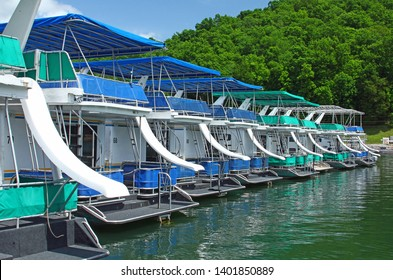 Dale Hollow Lake, Tennesee - May 9, 2019: row of houseboats with slides