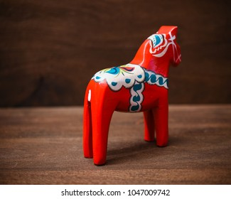 Dalecarlian horse - traditional carved Swedish painted wooden statue of a horse