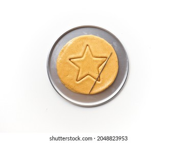 Dalgona or Ppopgi honeycomb candy with star shape on white background - Shutterstock ID 2048823953