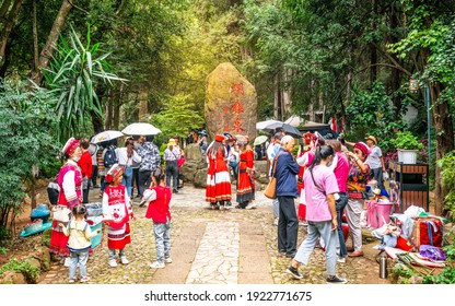 Dali China , 6 October 2020 : Group of Chinese tourists wearing traditional Bai minority dress and stone of the Butterfly spring park in Dali Yunnan China