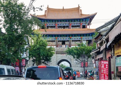 """Dali, China - April 19,2017 : """"Anyuan Tower"""",the North Gate of Dali is a classic architecture representation of China's Ming Dynasty. People can seen exploring around it."""
