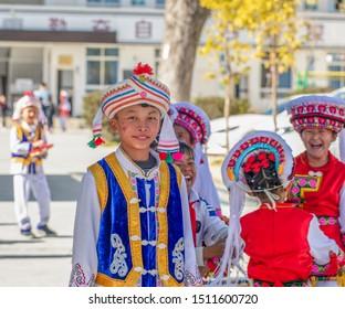 Dali, China - December 27, 2018: A Bai boy dressed in traditional Bai clothings in a public primary school in Dali, Yunan, China.