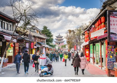 Dali, China - January 6, 2017: Tourists walking outside of the wall of the old town of Dali, the ancient kingdom of Nanzhao