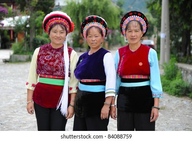 DALI, CHINA - JULY 22: women of Chinese Bai ethnic minority pose for camera before making batik (textile dyeing) on July 22, 2011 in Dali, China. These people depend on batik as a way to make a living