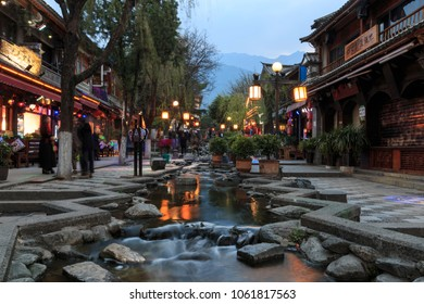 Dali, China - March 22, 2018: Chinese Tourist walking in Dali Old Town in Yunnan in the evening
