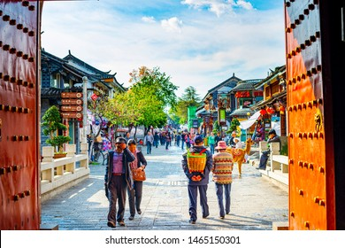 Dali, China - March 24, 2014: People are walking in Dali Ancient City (Dali Old Town). Located in Dali, Yunnan, China.