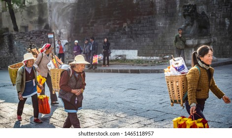 Dali, China - March 26, 2014: People are walking in Dali Ancient City (Dali Old Town). Located in Dali, Yunnan, China.
