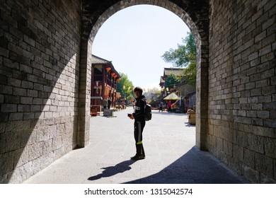 Dali City, Yunnan, China - 22 Jan 2019: Capture the stone city gate of Dali ancient city.