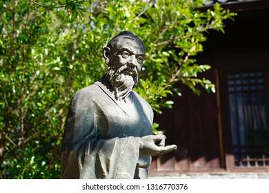 """Dali City, Yunnan, China - 22 Jan 2019: A sculpture of """"God of Tea"""" Lu Yu at Dali City"""