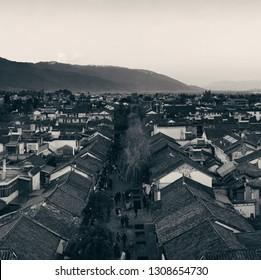 Dali old town rooftop view at sunset. Yunnan, China.
