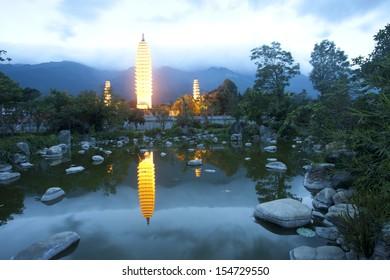 Dali three white pagodas and Cangshan Mountain in the night,dali,yunnan