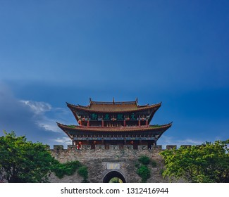 Dali, Yunnan, China - Aug. 1, 2016: View of traditional Chinese gate tower building in old town of Dali under sky and clouds, in Dali, Yunnan, China