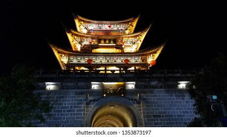 Dali, Yunnan, China - November, 2018. One of the ancient gates of the city of Dali at night, Yunnan, China