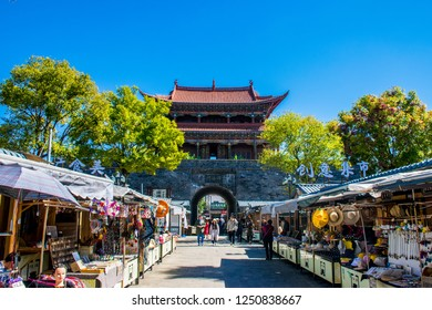 Dali, Yunnan Province / China - Oct 2018: Ancient Chinese architecture turret building in Old Town at sunny day. he translation for the non-English words is Dali Old Town and Wuhua building.