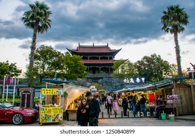 Dali, Yunnan Province / China - Oct 2018: Ancient Chinese architecture turret building in Old Town at cloudy day. The translation for the non-English words is Dali Old Town and Wuhua building.