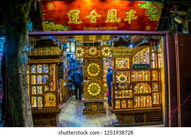 """Dali, Yunnan province / China - Oct 2018: Ancient Chinese architecture in Old Town. Nigth market street full of tourists, shops and restaurants. The translation is """"Dali Old Town market street""""."""