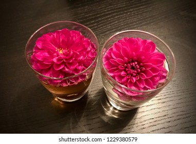 Dalia flowers floating in a water glass