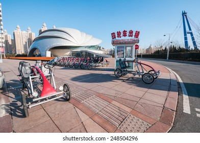 Dalian, China - January 19, 2015 : Four wheels bikes for rent at Xinghai square. The Square covers total area of 1.1 million square metre, making it the largest city square in the world.