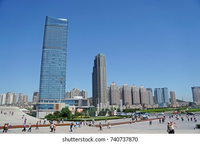 "DALIAN, CHINA - June 11, 2017: Tourists walking around at Xinghai Square, Dalian, the largest city square in the world, Its name literally means ""the Sea of Stars""."