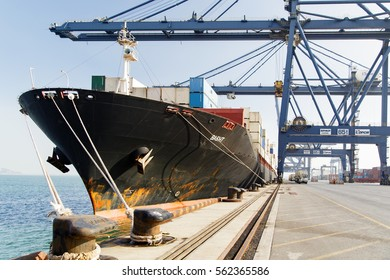 Dalian, China - November 22th, 2014: Port Dalian, container ship Basht at a mooring under cargo operations.